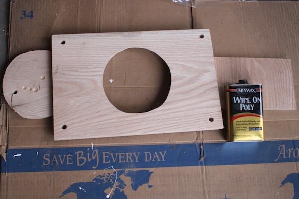 Applying wipe on poly on wooden board.