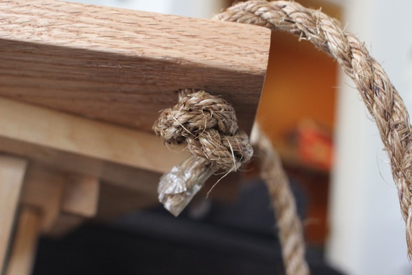 diy wooden plant hanger tie rope under board