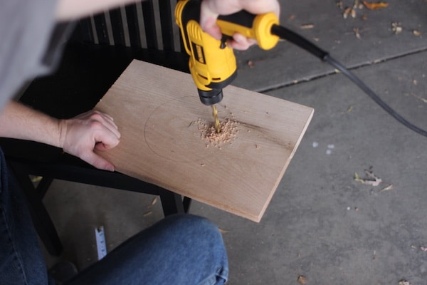 diy wooden plant hanger drilling into wood