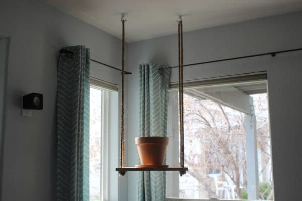 diy wooden plant hanger pot on board hanging from ceiling