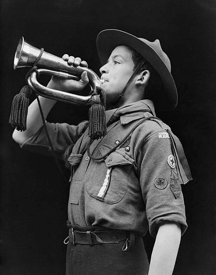 vintage boy scout playing bugle black white