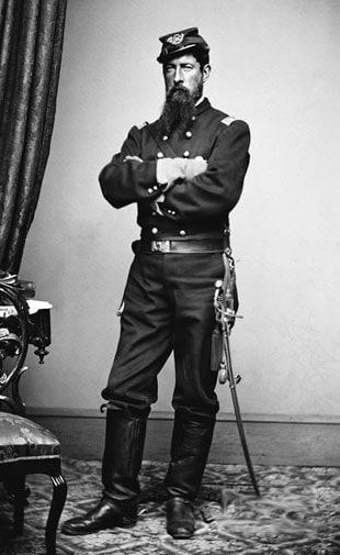 Vintage soldier is standing in uniform.