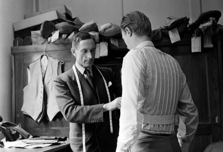 vintage tailor taking man's measurements