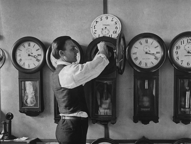 Vintage man repairing clocks.