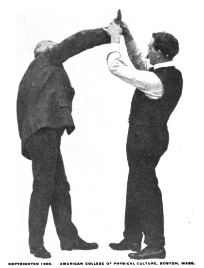 Raise your opponent's arm, taking hold with both hands illustration.