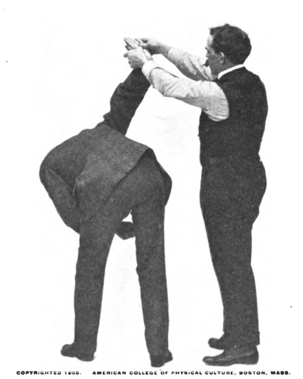 Raise your opponent arm which will cause him to bend forward illustration.