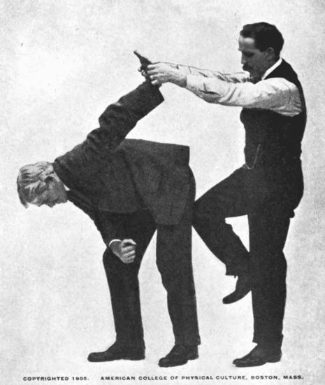 Holding your opponent's arm upward, kick his back illustration.