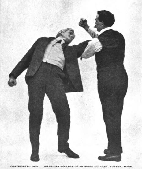 Grasp your opponent and Pressing him downward illustration.