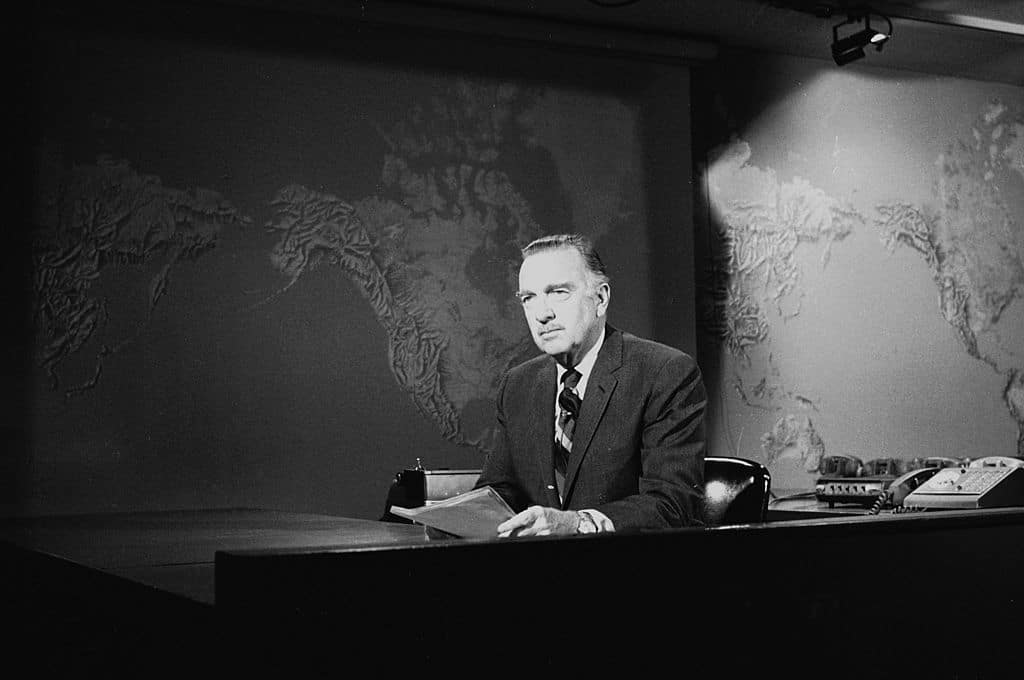 Walter cronkite at news desk on tv.