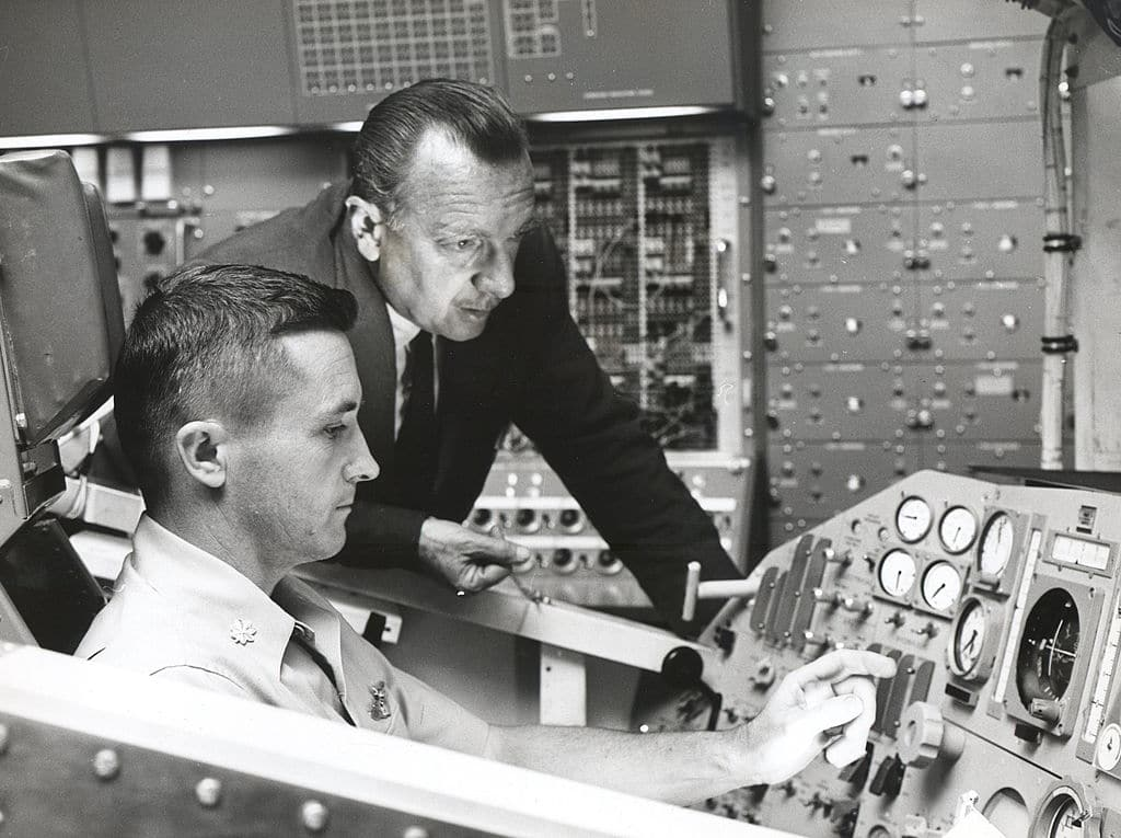 Walter cronkite at nasa with space engineer.