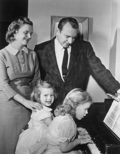 young walter cronkite with family at piano