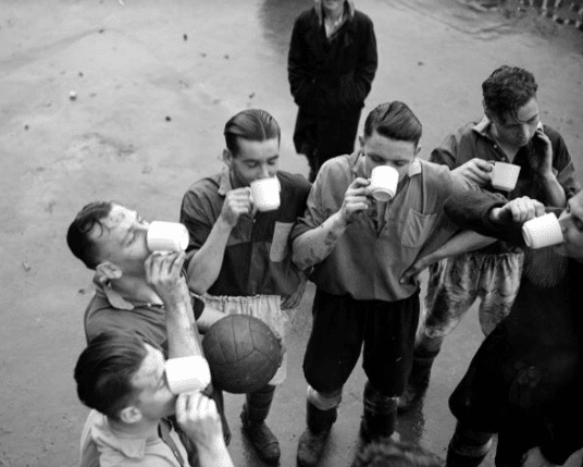 vintage group of men drinking tea from mugs