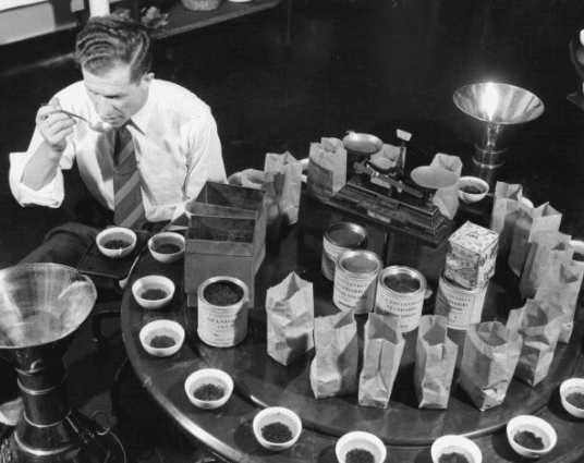 vintage man tasting various types of tea