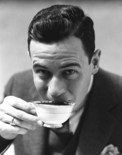 vintage man drinking tea from teacup