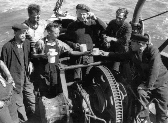 vintage laborers drinking tea on break