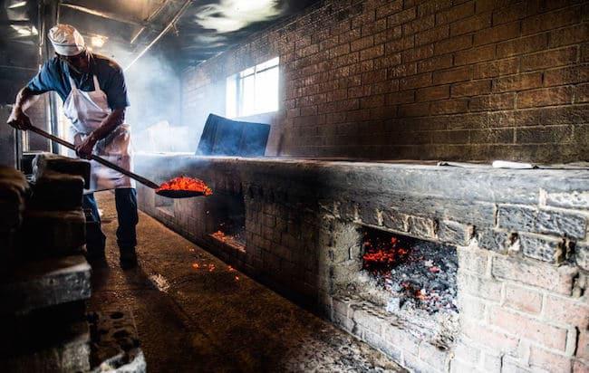 Men burning coals.