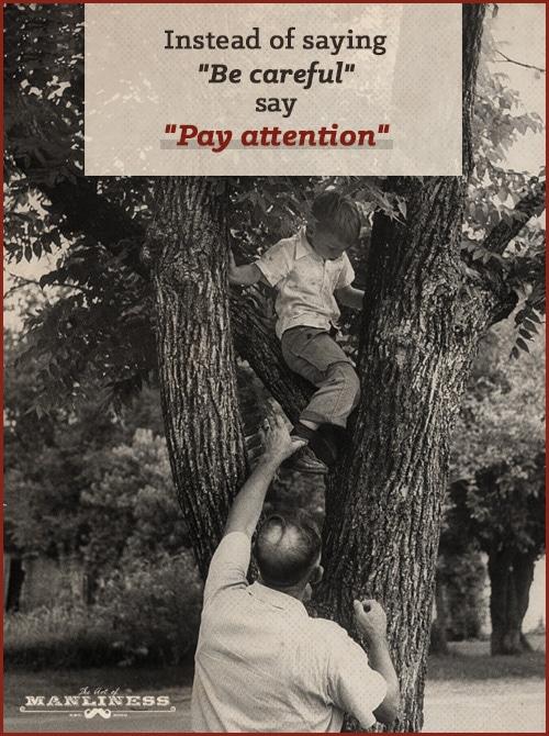 vintage dad helping boy climb tree