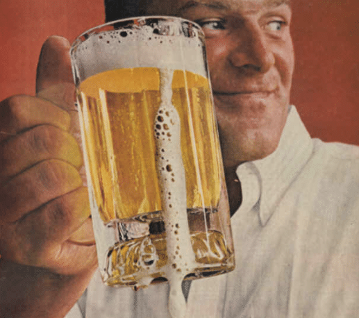Vintage illustration man holding mug of frothy beer.