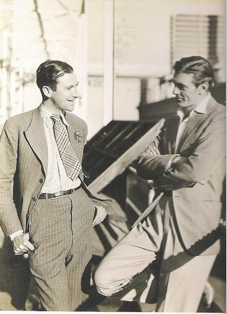 vintage men talking wearing suits pleats