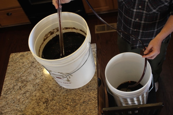 homebrew beer being transferred to bottling bucket