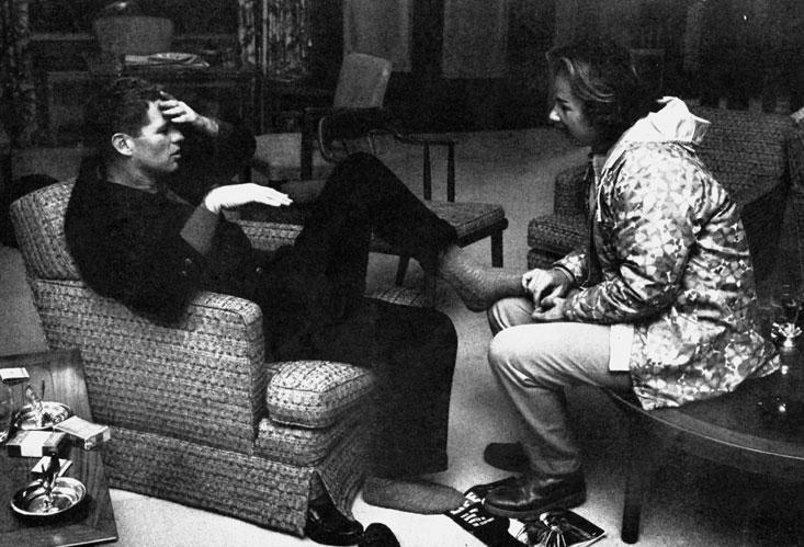 Bobby robert kennedy getting feet rubbed after 50 mile march by a woman.