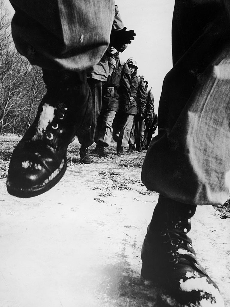Vintage men marching close up boots in a row.