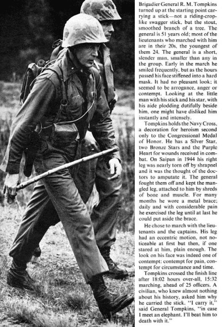Life magazine r m tompkins 50 mile march with marines holding a stick.