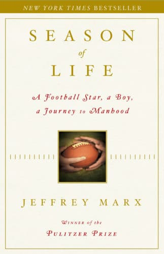 Season of life, by jeffrey marx, book cover hands holing a ball.