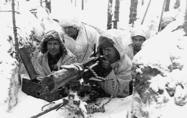 Finnish soldiers aiming looking through sight of large gun wwii.