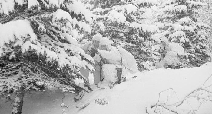 Finnish soldiers camouflaged in snow white uniforms wwii.