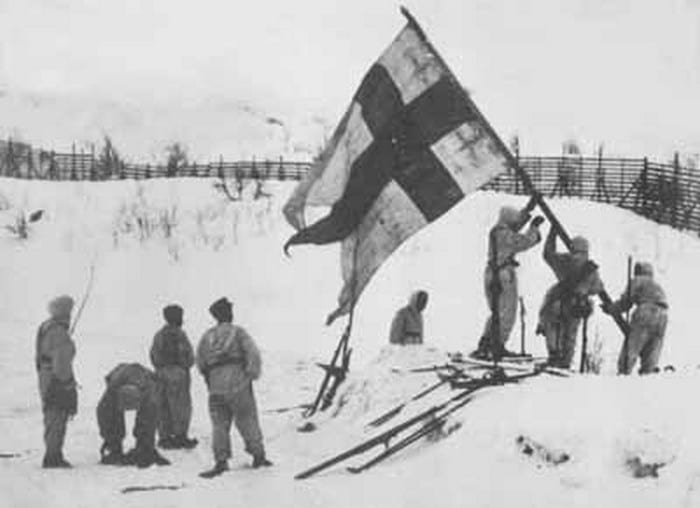 Finnish soldiers raising finland flag wwii.