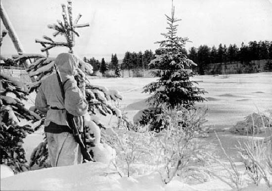 Finnish soldiers looking across winter landscape wwii.