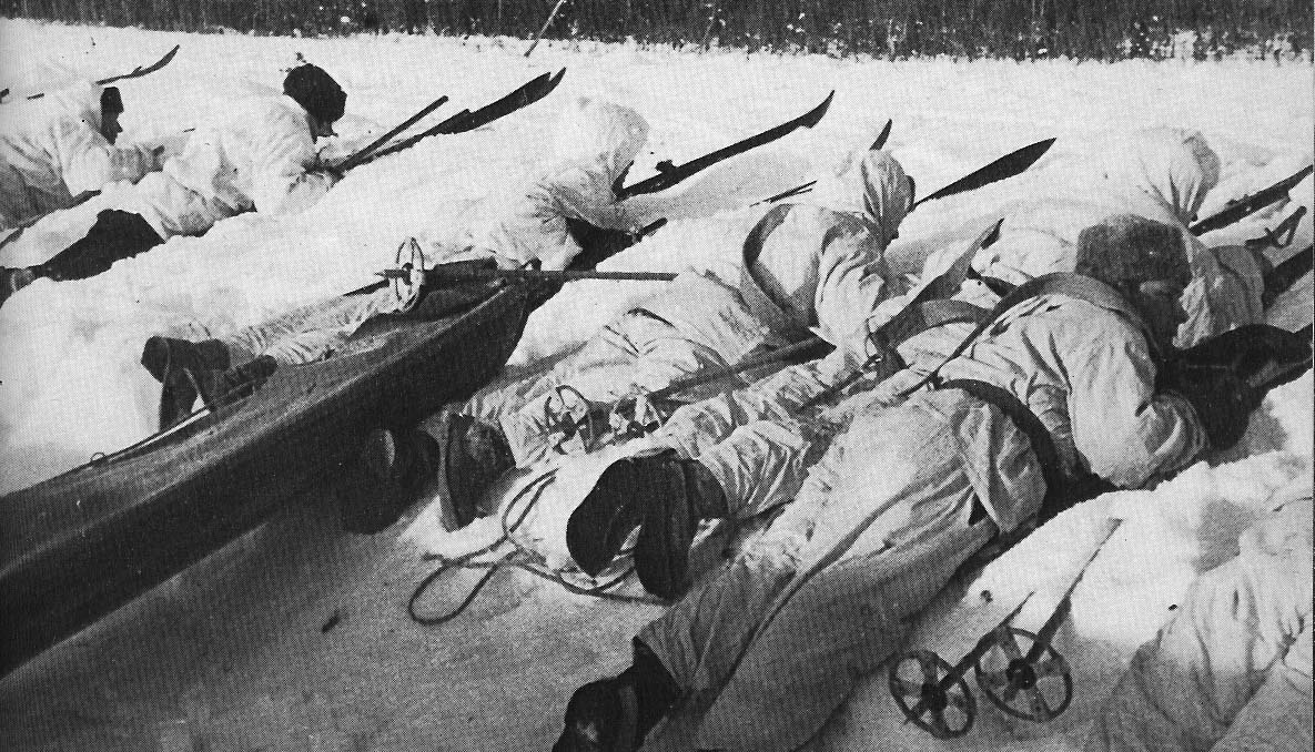 Finnish soldiers lying down in snow aiming rifles wwii.