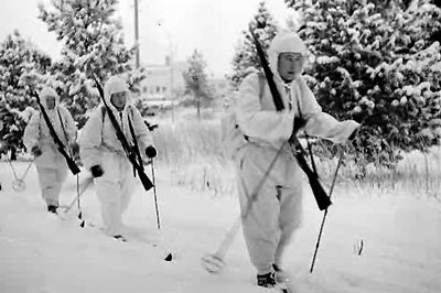 Finnish soldiers on skis with rifles wwii.