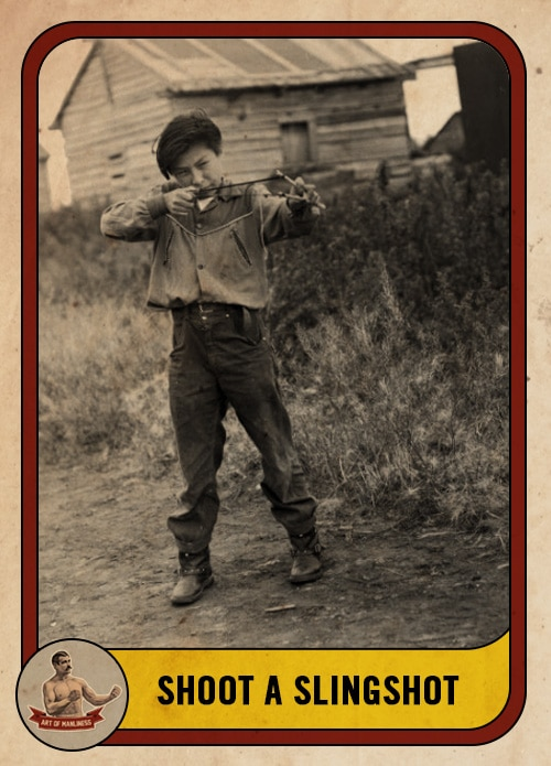 vintage boy shooting a slingshot in a field