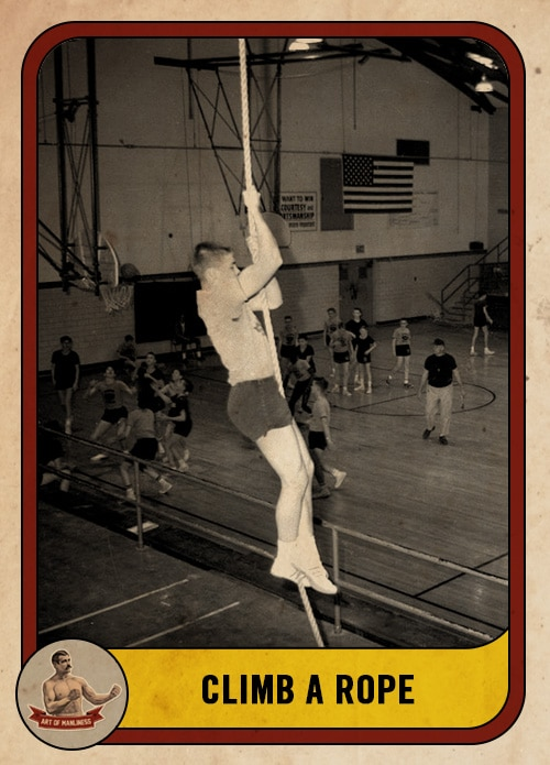 vintage young man climbing rope in gym class