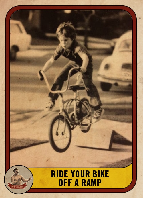vintage young boy riding jumping bike off a ramp