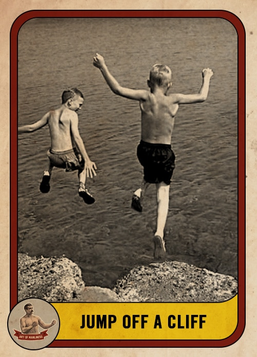 vintage boys jumping off a cliff into a lake