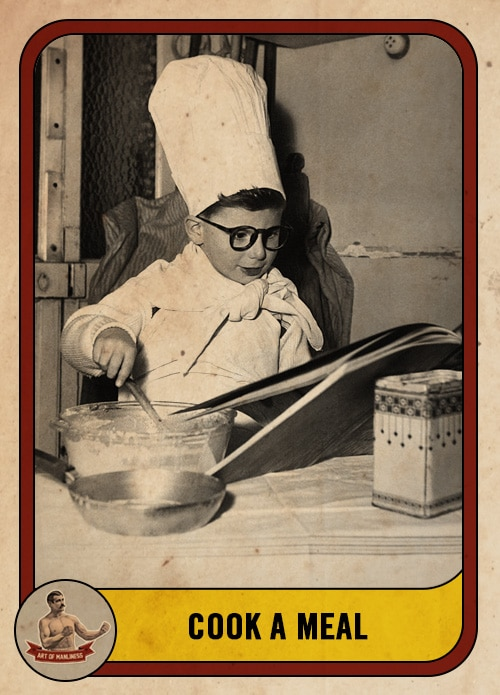 vintage boy cooking and wearing chef's hat stirring ingredients in kitchen