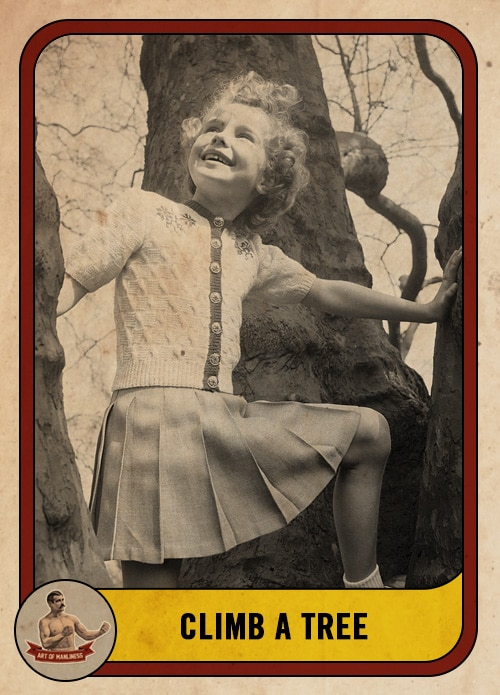vintage girl climbing a tree smiling