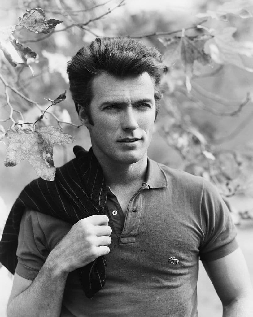 vintage clint eastwood wearing polo far off look in his face