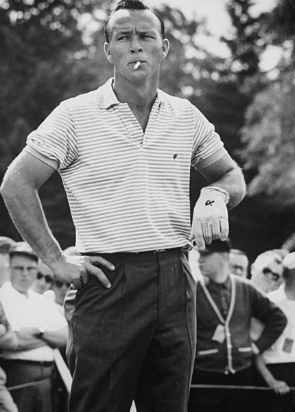 vintage arnold palmer smoking cigarette wearing polo on golf course