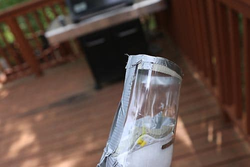 Improvised gas mask tutorial bottle edges duct taped to cover corners.