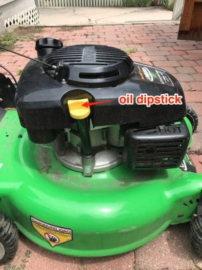 How to locate the oil dipstick on a lawnmower.