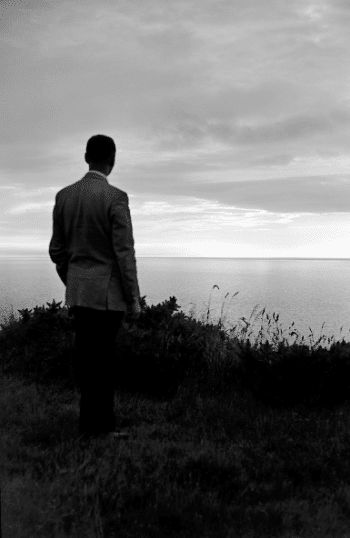 vintage man staring out over the ocean