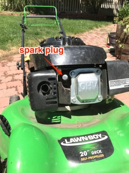 How to locate spark plug on a lawn mower.