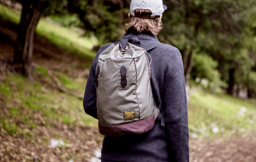 A man walking with a bag pack.