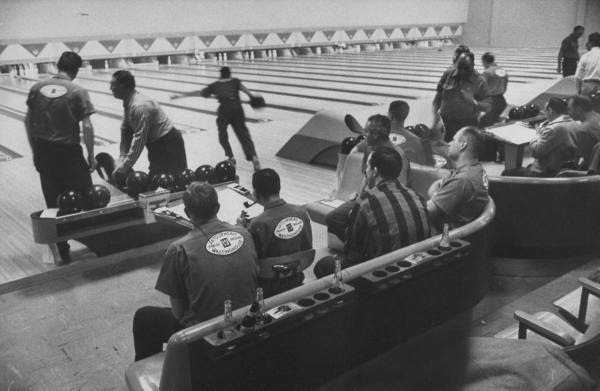vintage bowling alley men wearing league shirts