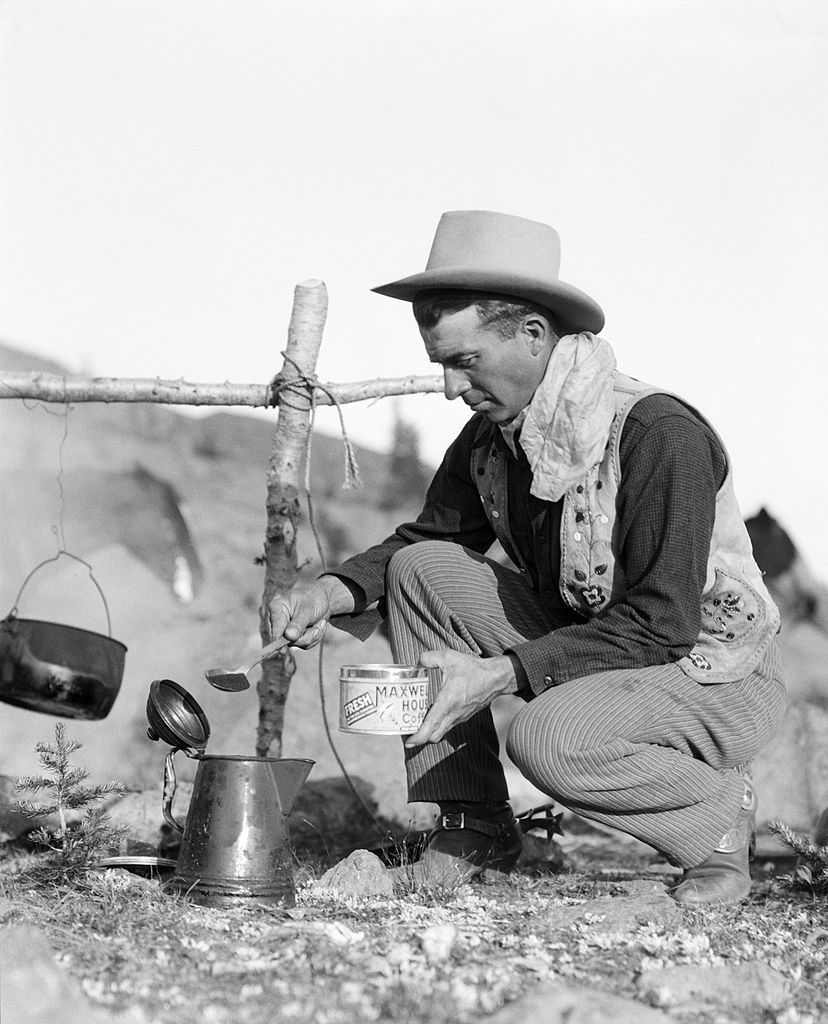 vintage cowboy making maxwell house coffee over a fire