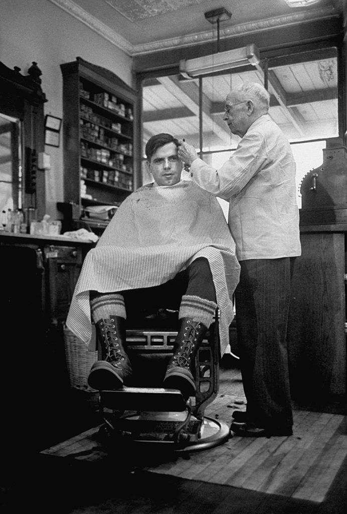 vintage man at a barbershop getting a haircut